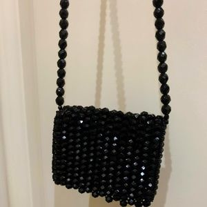 Gucci Small shoulder key purse made of  onyx beads
